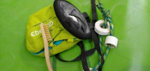chalk bag with brush and climbing tape